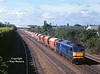 60078 heads North through Burton-on-Trent at 09:33 on the 28th June 2002 with the 6M11 08:20 Washwood heath - Peak Forest empty stone hoppers.