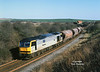 60087 rounds the curve at North Skelton at 14:30 on Saturday 18th March 2000, with a Boulby Mine - Tees Dock service.