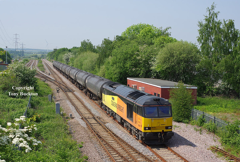 60087 brings the 08:55 Colas Ribble Rail (Preston) - Lindsey Oil Refinery empty tanks through Skellow Jnc at 12:52 on Monday21st May 2018.