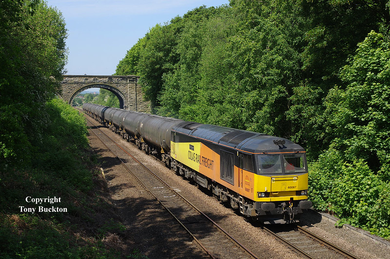 60087 brings the 08:55 Colas Ribble Rail (Preston) - Lindsey Oil Refinery empty tanks through the cutting at Oakenshaw at 12:36 on Thursday 24th May 2018.