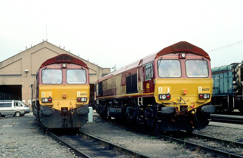 The first and last of the EWS rubbish 66001/66250 Old Oak Common 5th Aug 2000