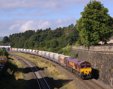 66077 passes through Chinley Station with 6H60 Hope Street - Peak Forest empty stone hoppers, 08/09/12.
