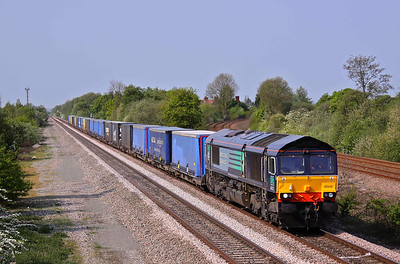 66432 passes North Stafford Junction with the diverted 4S49 Daventry - Grangemouth intermodal. 30/04/11.