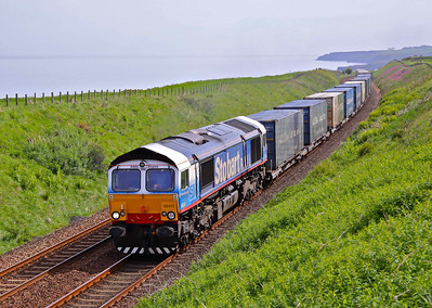 66411 'Eddie the Engine' heads North past Logie, near Stonehaven with 4A13 12:20 Grangemouth - Aberdeen Asda/Malcolm containers. 03/06/10.