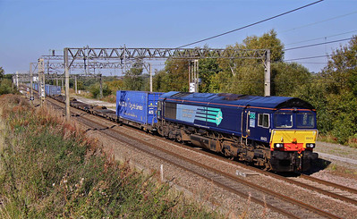 66423 speeds South at Weaver Junction with 4M44 08:50 Mossend - Daventry. 28/09/11.