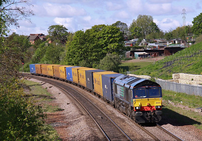 66431 passes Primrose Bridge, Rotherham with 4E38 Ditton - Tees Dock containers, 12/05/12.