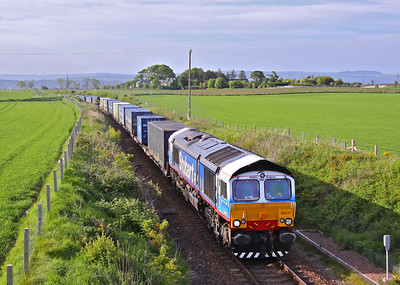 66411 'Eddie the Engine' is about to come to the end of the single line section at Usan, just South of Montrose with 4N83 17:20 Aberdeen - Grangemouth containers. 03/06/10.