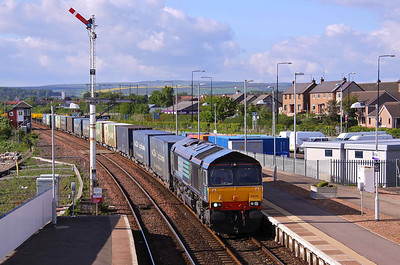 66432 enters Montrose Station with 4N83 (Sunday's) 16:51 Aberdeen - Grangemouth containers. 30/05/10. The footbridge has been moved further down the platform and the tall signal has been replaced by a short one and moved along side the signal box