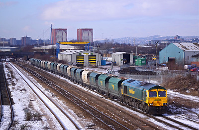 66624 propels back past Midland Road Freightliner depot, Leeds with the late running  6Z18 11:41 Stourton - Barrow Hill empty hoppers on 22/02/10.