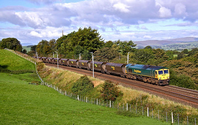 66621 passes Beck Houses as it heads North with 4Z52 06:50 Fidlers Ferry - Carlisle empty coal hoppers, 17/09/10.