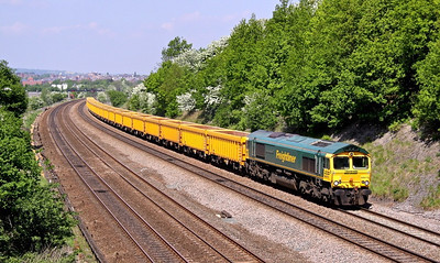 66619 passes Hasland, South of Chesterfield with 6M23 10:30 Doncaster - Mountsorrel empty ballast boxes, 24/05/10.