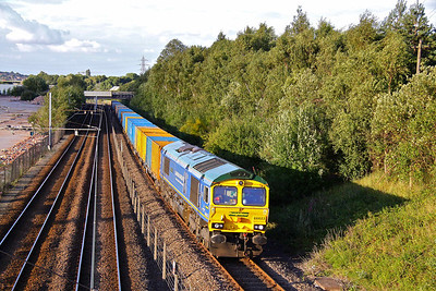 66623 'Bill Bolsover' in Bardon Aggregates blue livery, heads 6M06 17:04 Roxby - Bredbury empty 'binliner' past Carbrooke along side the Supertram system in Sheffield. 05/08/10.  The demolition of the industrial premises on the left has opened up this location, but for how long??