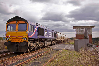 66726 'Sheffield Wednesday' passes Freemans Crossing on the start of its journey to the West Highlands of Scotland; the 11:52, 6S45 North Blyth - Fort William tanks, on 13/04/11.