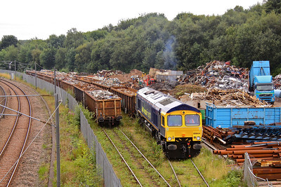 66844 waits in Crossley Evans scrap yard, Shipley as its train is marshalled by the yard shunter (01507). The train will form 6V67 10:57 to Cardiff Tidal. 18/08/09.