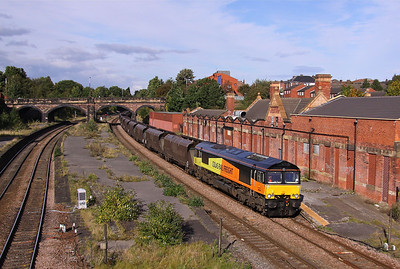 66848 passes through the dis-used platforms of Masbrough, Rotherham with 6M86 Wolsingham - Ratcliffe loaded coal, 28/09/12.