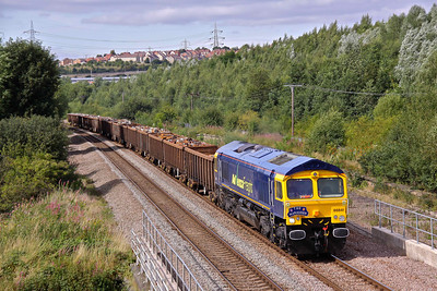 66841, in the short lived Advenza Freight livery passes Beighton with 6V67 13:45 Shipley - Cardiff Tidal loaded scrap metal working. 12/08/09.