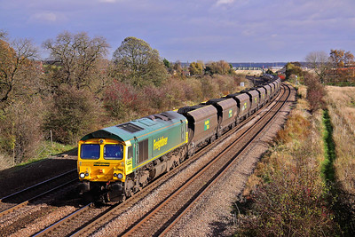 66952 passes Knabbs Bridge, New Barnetby in an every day scene, working 6M51 11:45 Immingham - Rugeley Power Station loaded coal. 02/11/09.