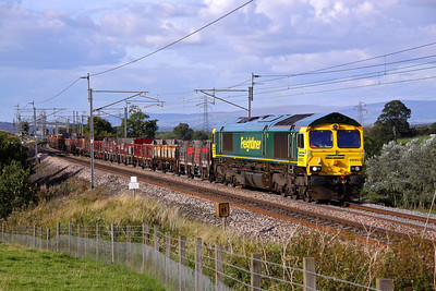 66953 hauls a motley rake of wagons past Great Strickland. The working is 6K27 16:03 Carlisle Yard - Crewe Basford Hall. 17/09/10.