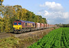 66250 Passes West Bank Hall Crossing on the Drax Branch at 13:12 on Tuesday 1st November with empty limestone hoppers to Tunstead.