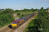 What a difference 30 mins makes - the shadows that were licking the rails when 6D71 passed have completely receded. 66170 has just passed Brough at 07:14 on Thursday 21st June 2018 with the 05:40 Masborough F.D. - Hedon Road Sidings steel hoods.<br />  Luckily, delays to the re-signalling scheme have left the semaphores in place for the summer, and by the summer solstice of 2019 will almost certainly be history. (The new system is in place and should have been commissioned at Easter).