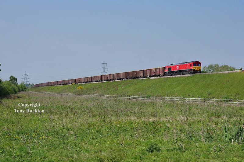 66044 leads the 14:15 Kellingley Colliery - Killingholme over the flyover at Joan Croft on the afternoon of Monday May 21st 2018.<br /> Known as the North Doncaster Chord, the flyover links the Askern line with the Skellow line, removing the need for freights from the Knottingley area to clog up the ECML.