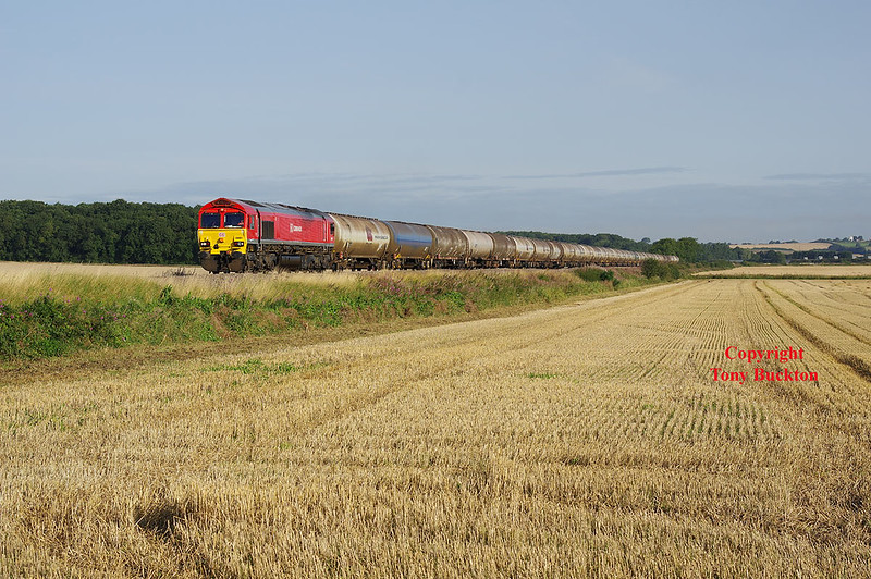 66001 passes Howsham at 07:58 on the morning of Thursday 24th August 2017 with the 07:18 Lindsey Oil Refinery - Kingsbury Oil Sidings. A previous attempt at this shot a week or so earlier would have been much better had the light lasted - at that time the crop in the field was un-harvested and the Rosebay Willowherb on the banks was in full bloom - not to mention the class 60 at the helm - Oh well you can't win em all!