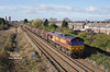 66061 heads for Hull  as it passes just East of Goole station at 09:48 on Tursday 9th March 2017 with the 08:18 Masborough - Hedon Road Sidings steel hoods.