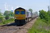 66724 passes Carlton on the branch serving Drax Power Station with empty coal hoppers - 10:55 Monday 28th May 2012.