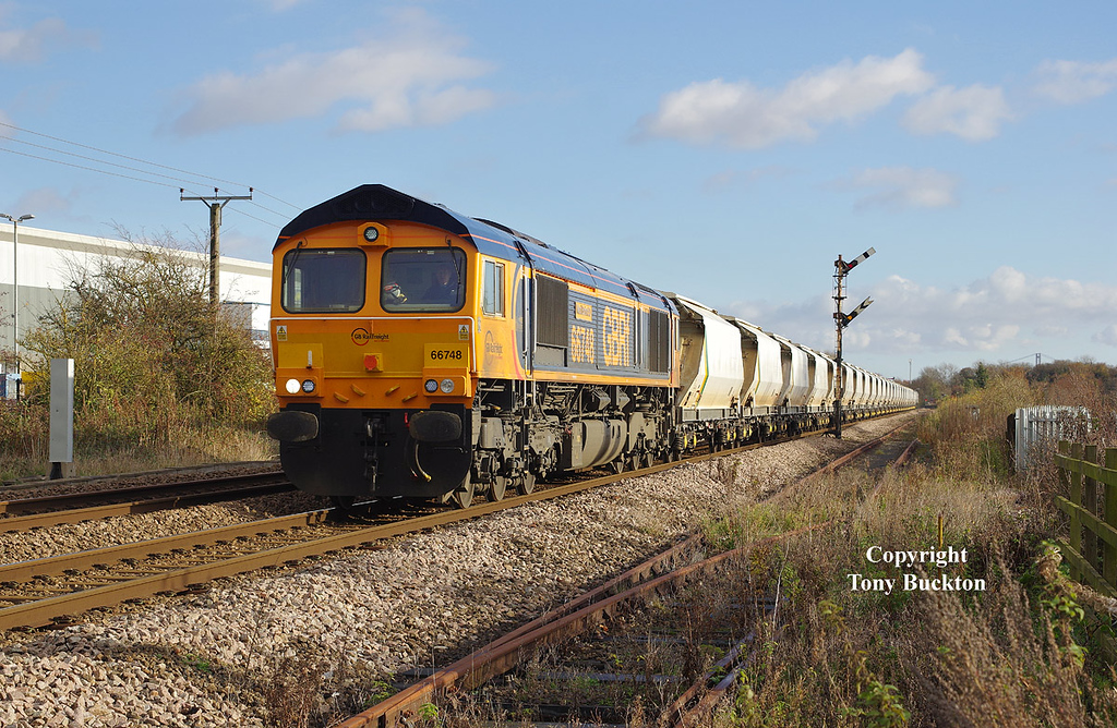 66748 passes Lowfield Lane, Melton, at 12:20 0n Saturday 19th November 2016 with the 6D72 11:57 Hull Dairycoates - Rylstone empty Tarmac Hoppers.
