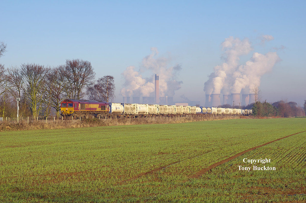With the cooling towers of Drax Power Station dominating the skyline, 66139 approaches West Bank crossing at 13:05 on Thursday 29th December 2016 with the 12:59 Drax - Milford West Sidings Flyash Tanks - the eventual destination for the Flyash being Appleford Sidings near Didcot.