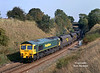 66523 rounds the curve at Tick Hill at 13:29 on Tuesday 1st October 2002 with an unidentified working from Immingham.