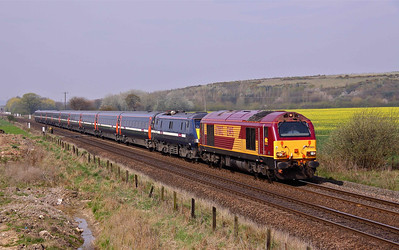 67002 'Special Delivery' hauls electric 91122 past Hambleton West with the diverted 1A23 10:32 Wakefield Westgate - Kings Cross. 24/04/10.