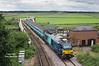 The return working (2J73 10:57 Lowestoft - Norwich) sees 68016 lead across the swing bridge at Reedham - 15/08/16