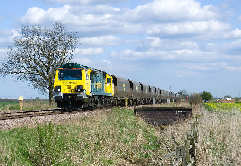On Wednesday 21st April 2010, 70003 passes Maud's Bridge with 4G71 12:55 Immingham Reception - Hunslet returning test run, the load being formed of a shortened formation of Freightliner coal hoppers.