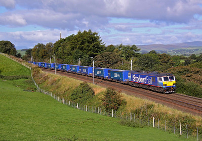 92017 passes Beck Houses with 4S43 06:22 Rugby - Mossend Tesco train. 17/09/10.
