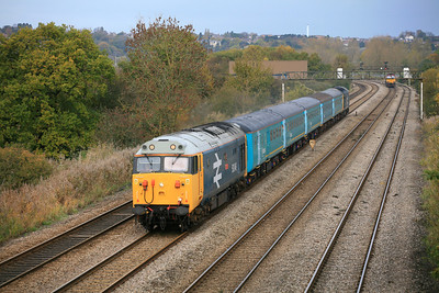 50049 heads past Duffryn, south-west of Newport, on a Gloucester to Cardiff rugby special at  on 11 November, 2006.  50031 was on the rear.  The photo was taken from a bridge carrying the unmade 'Lighthouse Road' (which leads to the marshes) over the main line.
