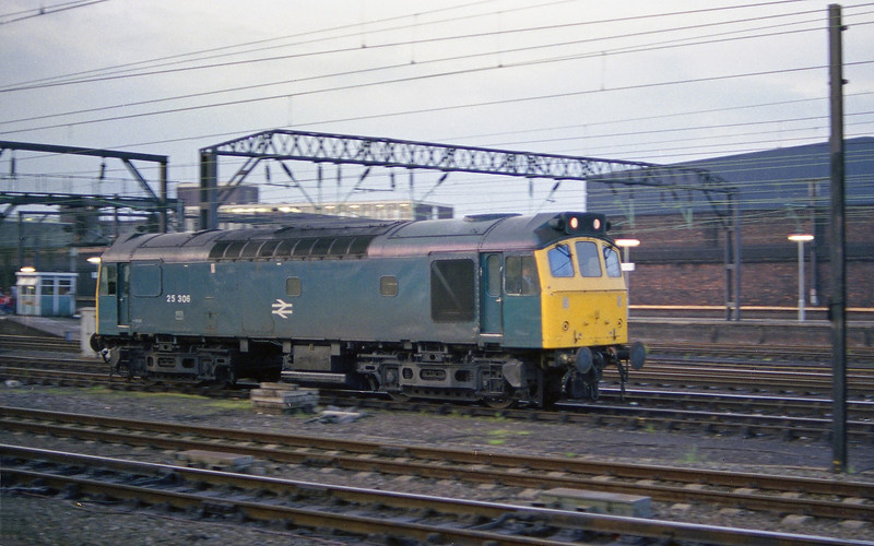 25306 runs light engine through Crewe on the evening of Friday 1st June 1984. Low light conditions required a slow shutter and some hand held panning to get this shot, and whilst not great, I have few photographs of these classes in traffic so have included it the collection.
