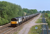 58022 passes Stenson Junction at 12:25 on the 19th May 1998 with an unidentified train of loaded MGR hoppers.