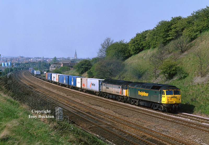 A regularly photographed Saturday working was the 4O31 14:35 Leeds - Southampton Freightliner. Seen passing Hasland, South of Chesterfield, at 15:37 on 6th May 2000 with 57001 leading 47370.