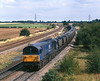 58046 passes Burton Salmon at 12:35 on the 18th August 1998 with an unidentified MGR working.