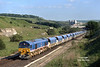 As the 59/2's were supposed to look! <br /> 59201 heads away from Great Rocks Jnc, Peak Forest, with loaded limestone hoppers for Drax Power station - 17:27 on Friday 23rd June 1995.