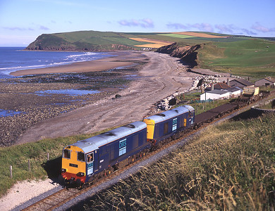 20301+20303 head south from St Bees with a short train to Sellafield 15/7/00.