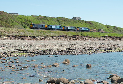 As the tide comes in on a scorching hot day 20302 hauls 37259 + 37688 + 37612 and 2 flasks northbound near Harrington 26/5/12.