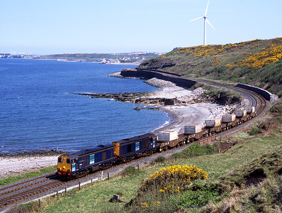 It doesn't get much better than this - bluebells, gorse, blue sea, blue sky and a pair of 20s on a (relatively) big flask train.  20307 + 20313 pass Lowca 10/5/06.