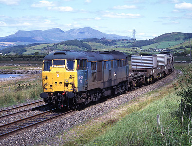With the Old Man of Coniston in the background 31450 hauls the Heysham flasks at Kirkby 15/7/96.