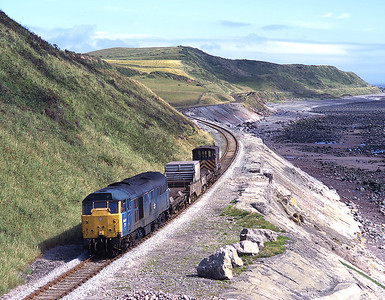 31467 hauls the Seaton flask along the sea wall near St Bees 9/7/96.