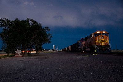 I stopped in Texline, TX to capture the train next to the State of Texas statue.