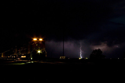 I stopped in Texline, TX to capture the train next to the State of Texas statue.  As I was standing there, the clouds rolled in and the lightning began.  I decided to turn my attention to the train with the lightning in the background.