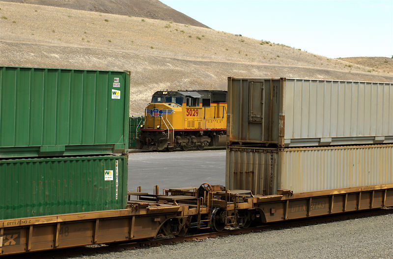 At its destination train pull onto pad for transloading containers to truck to carry them to the dumping site.