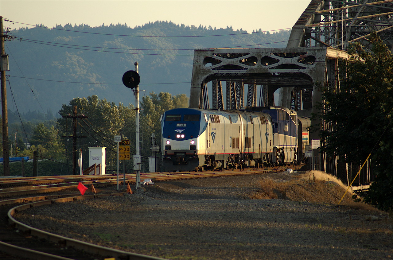 Northbound Coast Starlight comes off Columbia River drawbridge into Vancouver Station.